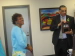 Mayor Baker proudly shows the plaque presented by HJTTI DE as Board Member Earlean Dickerson looks on.